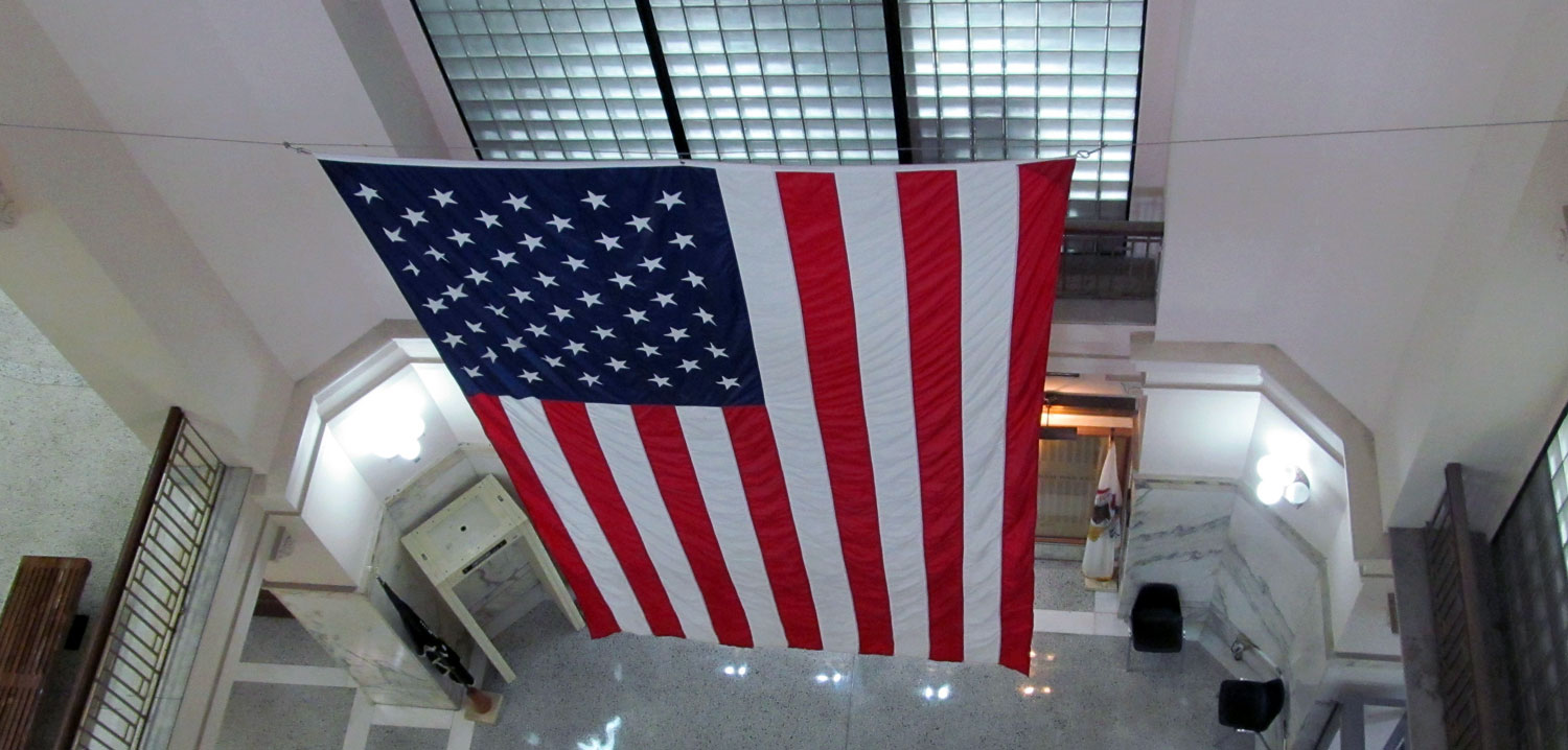 Interior photo of the U.S.A. flag within the Vermilion County Courthouse