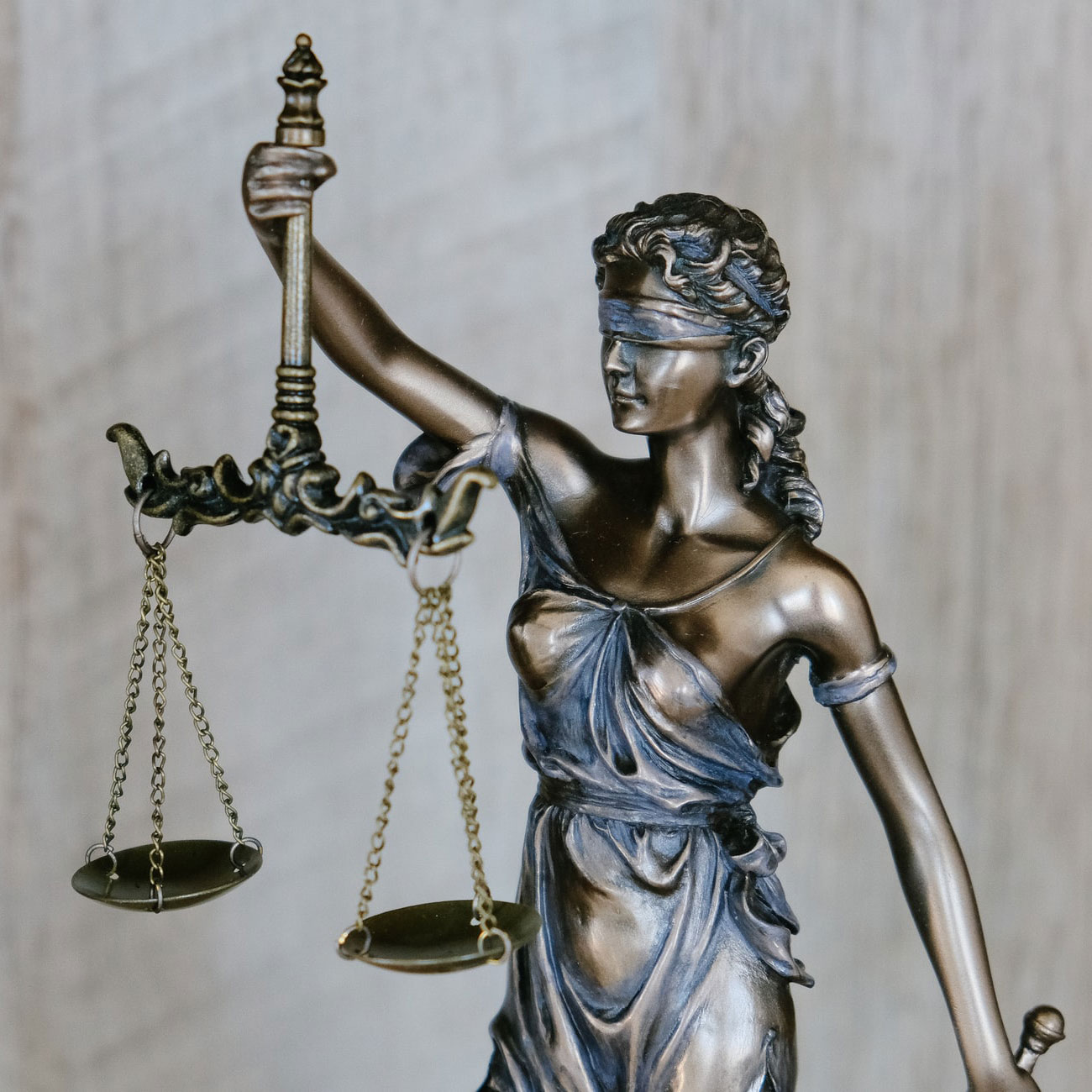 Statue of blind justice holding the scales of justice.