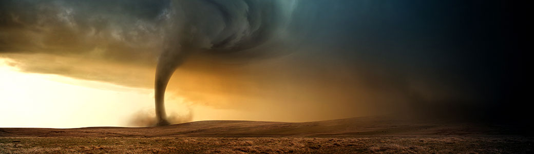 Illustration of a Tornado moving across open field